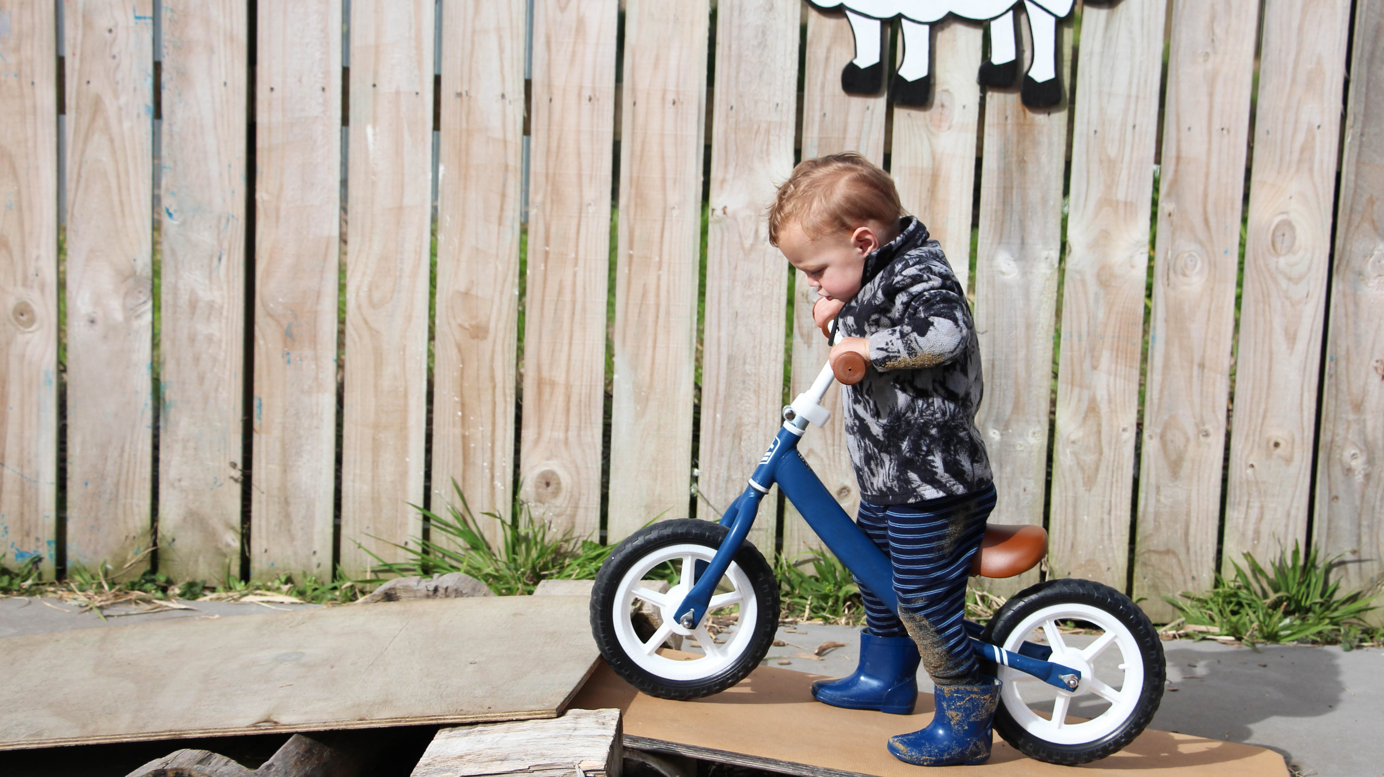 boy learning to ride