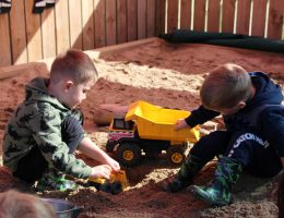 Preschool boys playing construction in the sandpit
