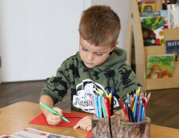 Preschool boy drawing
