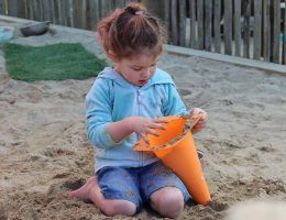 Girl playing in sandpit